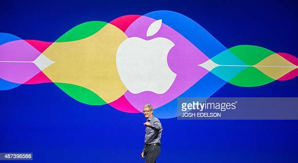 Apple CEO Tim Cook enters the stage at the start of a media event in San Francisco California on September 09 2015 Apple on Wednesday unveiled its...