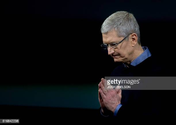 Apple CEO Tim Cook gestures during a media event at Apple headquarters in Cupertino California on March 21 2016 Apple on Monday unveiled a new iPhone...