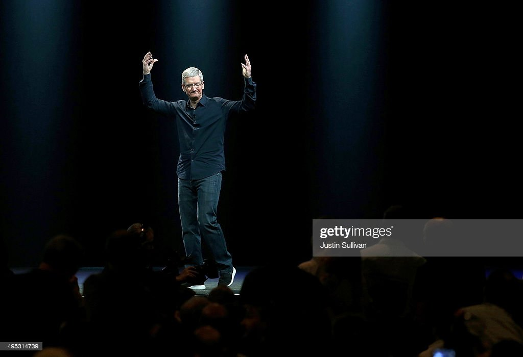 Apple CEO <a gi-track='captionPersonalityLinkClicked' href=/galleries/search?phrase=Tim+Cook+-+Business+Executive&family=editorial&specificpeople=8084206 ng-click='$event.stopPropagation()'>Tim Cook</a> gestures during the Apple Worldwide Developers Conference at the Moscone West center on June 2, 2014 in San Francisco, California. <a gi-track='captionPersonalityLinkClicked' href=/galleries/search?phrase=Tim+Cook+-+Business+Executive&family=editorial&specificpeople=8084206 ng-click='$event.stopPropagation()'>Tim Cook</a> kicked off the annual WWDC which is typically a showcase for upcoming updates to Apple hardware and software. The conference runs through June 6.
