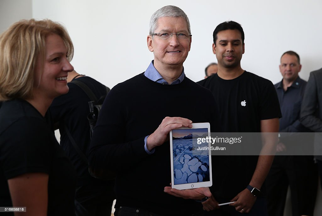 Apple CEO Tim Cook holds the new 9.7' iPad Pro during an Apple special event at the Apple headquarters on March 21, 2016 in Cupertino, California. Apple CEO announced the iPhone SE and a 9.7' version of the iPad Pro.