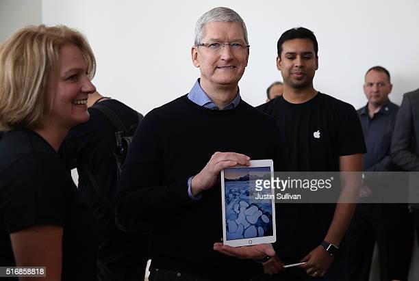 Apple CEO Tim Cook holds the new 97' iPad Pro during an Apple special event at the Apple headquarters on March 21 2016 in Cupertino California Apple...