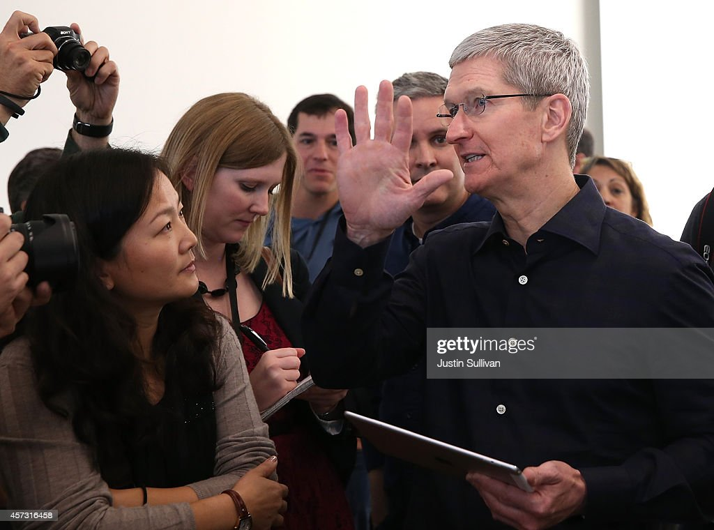Apple CEO Tim Cook holds the new iPad Air 2 as he speaks with reporters during an Apple special event on October 16 2014 in Cupertino California...