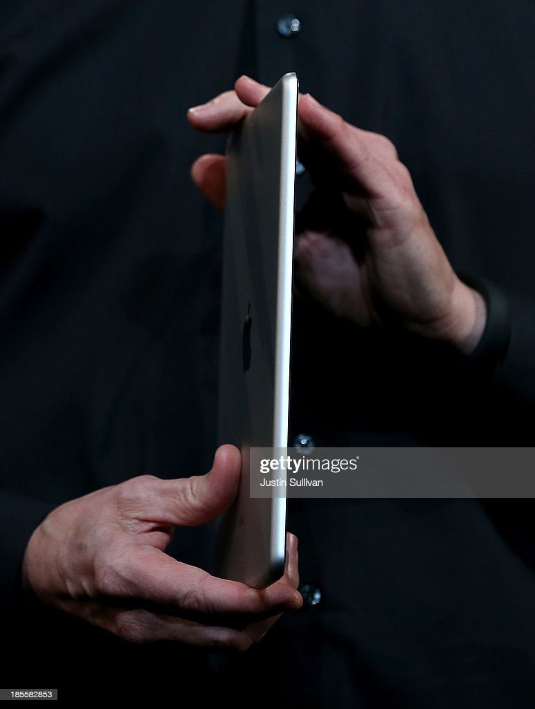 Apple CEO Tim Cook holds the new iPad Air during an Apple announcement at the Yerba Buena Center for the Arts on October 22, 2013 in San Francisco, California. The tech giant announced its new iPad Air, a new iPad mini with Retina display, OS X Mavericks and highlighted its Mac Pro.