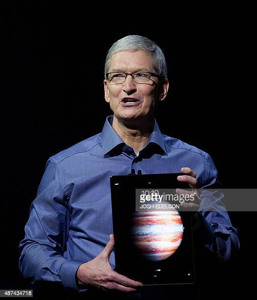 Apple CEO Tim Cook holds up the new iPad Pro at a media event in San Francisco California on September 09 2015 Apple on Wednesday unveiled its iPad...