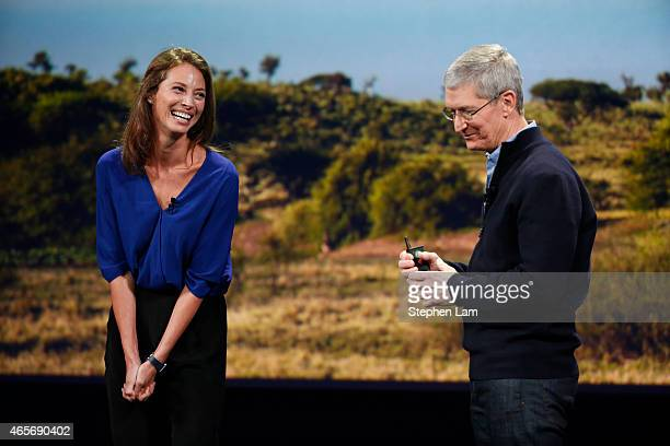 Apple CEO Tim Cook interacts with model Christy Turlington Burns on stage during an Apple special event at the Yerba Buena Center for the Arts on...
