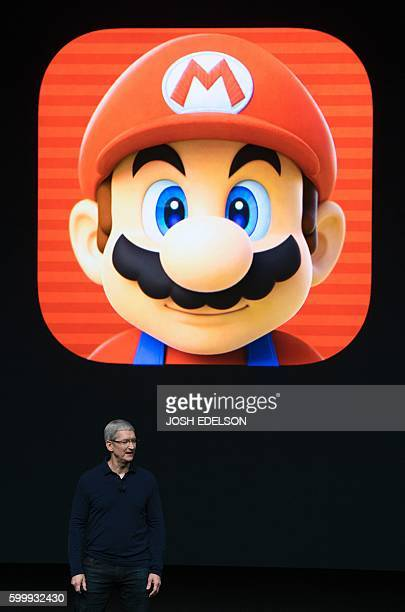 Apple CEO Tim Cook introduces a Super Mario game during an Apple event inside Bill Graham Civic Auditorium in San Francisco California on September...