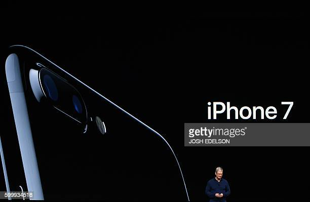 Apple CEO Tim Cook introduces the new iPhone 7 during an event inside Bill Graham Civic Auditorium in San Francisco California on September 07 2016 /...