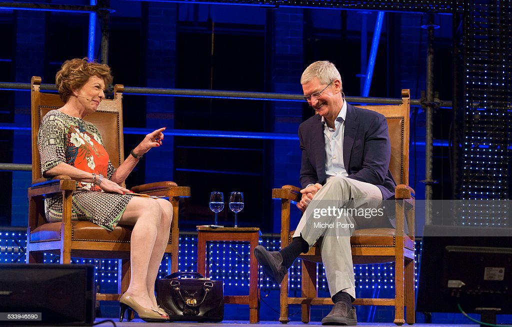Apple Ceo Tim Cook laughs about a remark made by Neelie Kroes during the kick-off of Startup Fest Europe on May 24, 2016 in Amsterdam, The Netherlands. The event facilitates match-making between investors and startup entrepreneurs from all over the world.