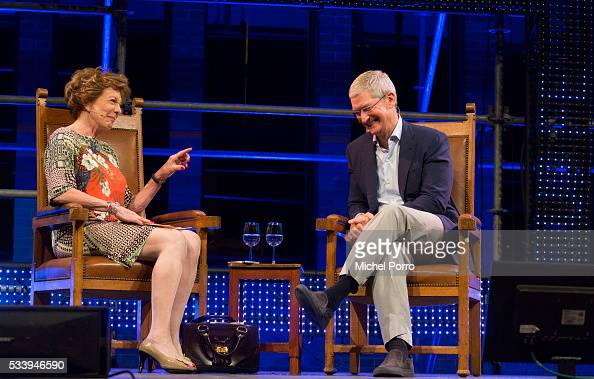 Apple Ceo Tim Cook laughs about a remark made by Neelie Kroes during the kickoff of Startup Fest Europe on May 24 2016 in Amsterdam The Netherlands...