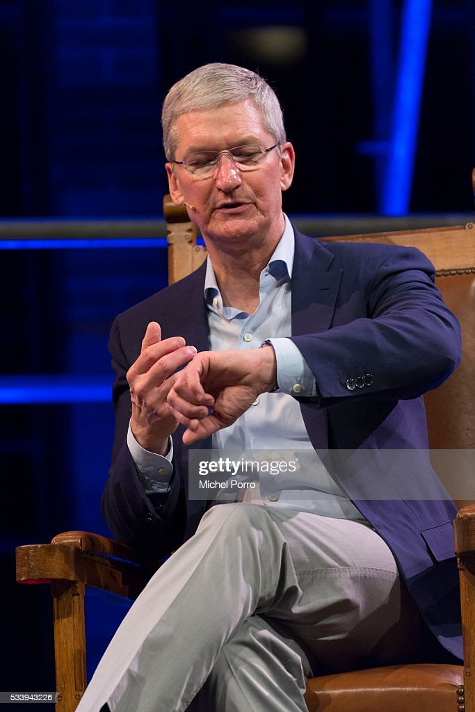 Apple CEO Tim Cook looks at his Apple watch during the kick-off of Startup Fest Europe on May 24, 2016 in Amsterdam, The Netherlands. The event facilitates match-making between investors and startup entrepreneurs from all over the world.