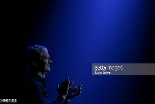 Apple CEO Tim Cook looks on as he delivers the keynote address during Apple WWDC on June 8 2015 in San Francisco California Apple annouced a new OS X...