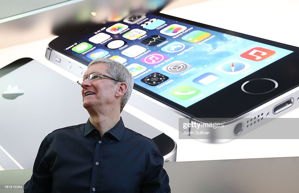 Apple CEO Tim Cook looks on at an Apple Store on September 20, 2013 in Palo Alto, California. Apple launched two new models of iPhone: the iPhone 5S, which is preceded by the iPhone 5, and a cheaper, paired down version, the iPhone 5C. The phones come with a new operating system.