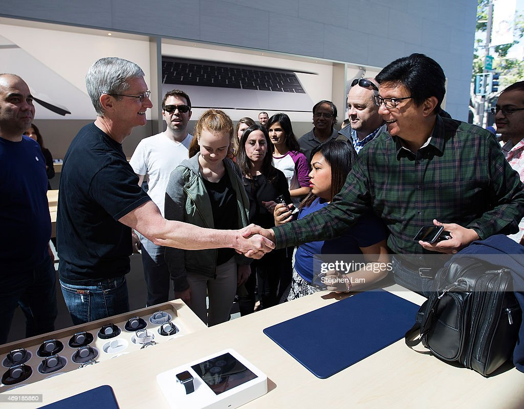 Apple CEO Tim Cook shakes hand with a customer at an Apple Store on April 10, 2015 in Palo Alto, California. The pre-orders of the highly-anticipated wearable from the tech giant begin today as the watches arrive at stores for customers to preview.
