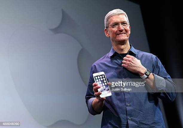 Apple CEO Tim Cook shows off the new iPhone 6 and the Apple Watch during an Apple special event at the Flint Center for the Performing Arts on...