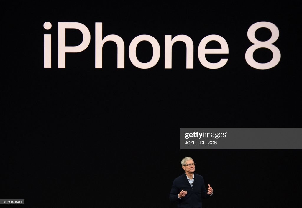 TOPSHOT - Apple CEO Tim Cook speaks about the new iPhone 8 during a media event at Apple's new headquarters in Cupertino, California on September 12, 2017. / AFP PHOTO / Josh Edelson