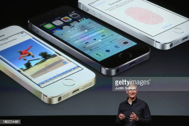 Apple CEO Tim Cook speaks about the new iPhone during an Apple product announcement at the Apple campus on September 10 2013 in Cupertino California...