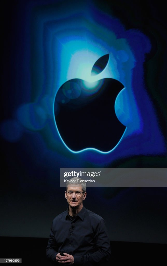 Apple CEO Tim Cook speaks at the event introducing the new iPhone 4s at the company's headquarters October 4, 2011 in Cupertino, California. The announcement marks the first time Cook introduces a new product since Apple co-founder Steve Jobs resigned in August. October 4, 2011 in Cupertino, California.