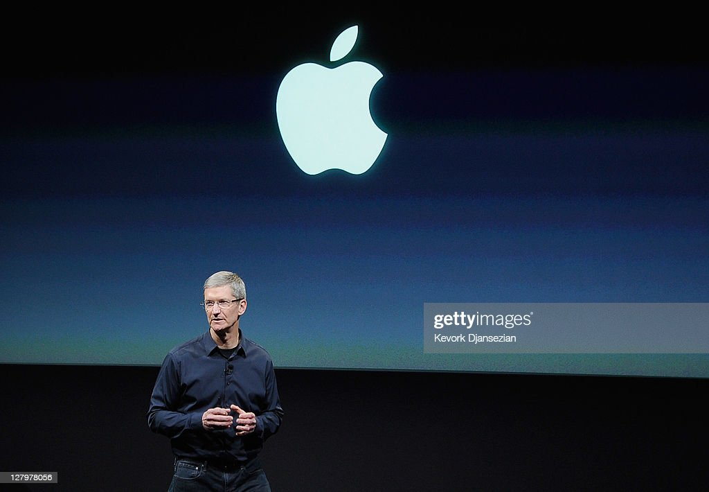 Apple CEO Tim Cook speaks at the event introducing the new iPhone at the company's headquarters October 4 2011 in Cupertino California The...