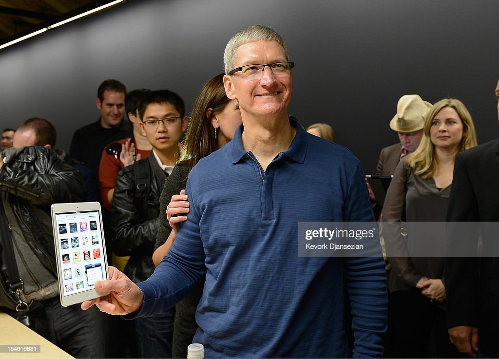 Apple CEO Tim Cook speaks displays the new iPad mini after it was unveiled during an Apple special event at the historic California Theater on October 23, 2012 in San Jose, California. The iPad mini is Apple's smaller 7.9 inch version of the iPad tablet.