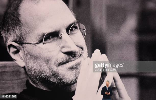 TOPSHOT Apple CEO Tim Cook speaks during a media event at Apple's new headquarters where Apple is expected to announce a new iPhone and other...
