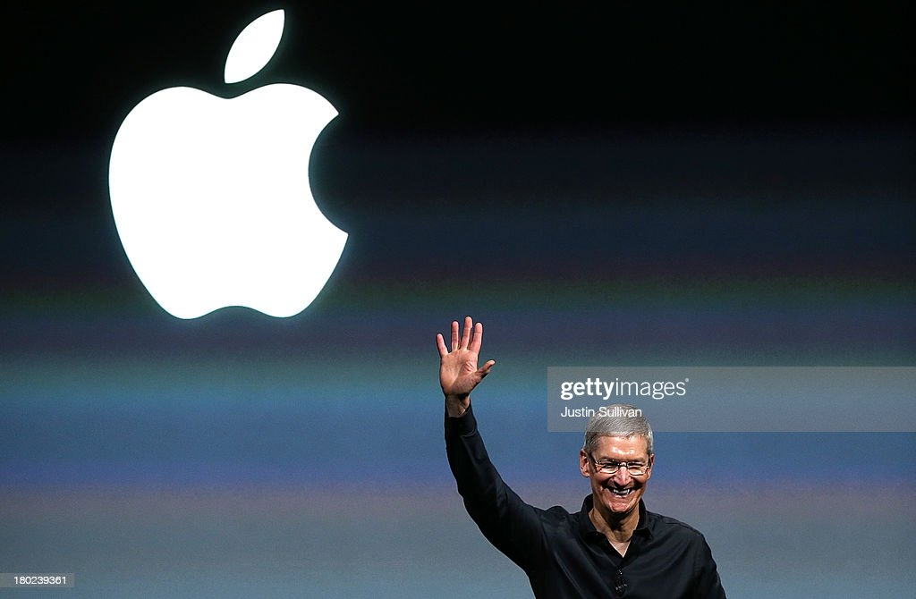 Apple CEO Tim Cook speaks during an Apple product announcement at the Apple campus on September 10, 2013 in Cupertino, California. The company launched the new iPhone 5C model that will run iOS 7 is made from hard-coated polycarbonate and comes in various colors and the iPhone 5S that features fingerprint recognition security.