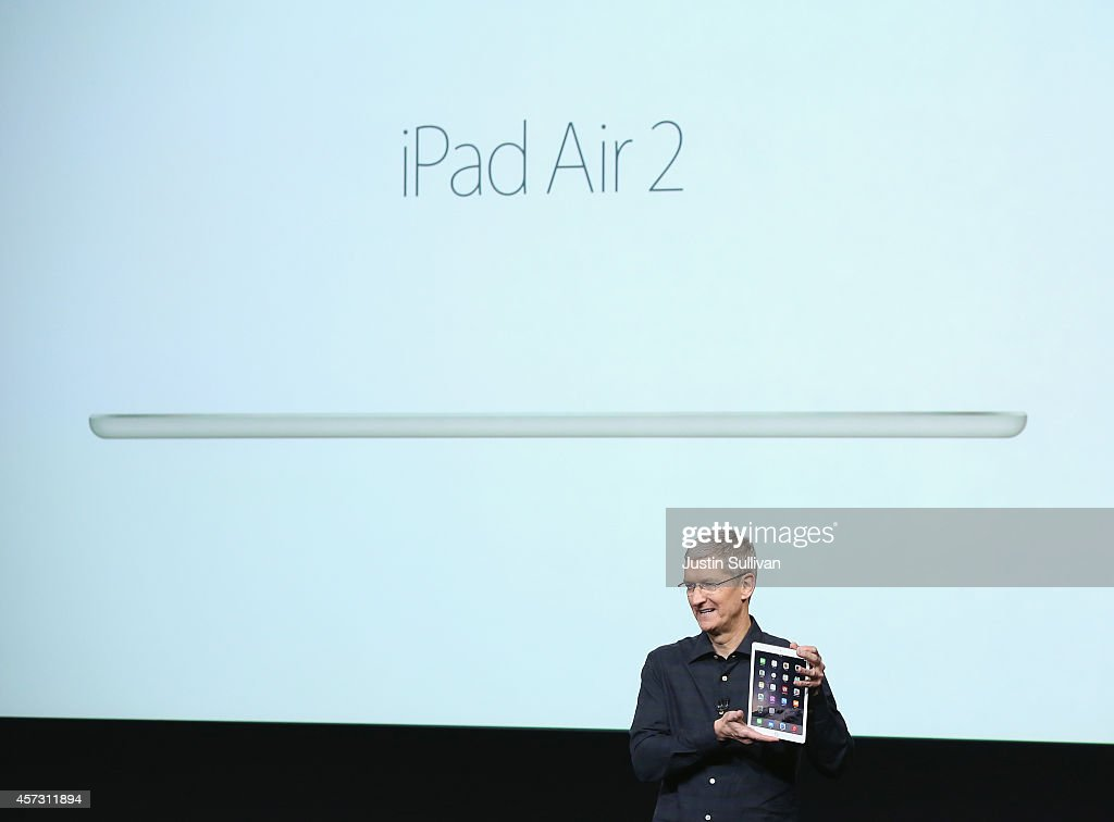 Apple CEO Tim Cook speaks during an event introducing the new iPad Air 2 and iPad Mini 3 at Apple's headquarters October 16 2014 in Cupertino...