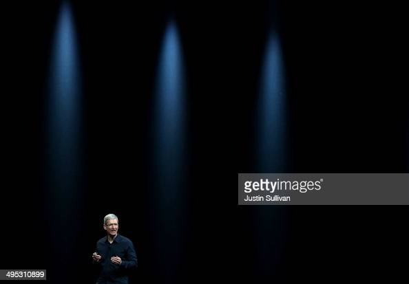 Apple CEO Tim Cook speaks during the Apple Worldwide Developers Conference at the Moscone West center on June 2 2014 in San Francisco California Tim...