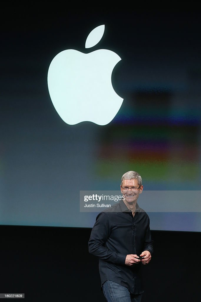 Apple CEO Tim Cook speaks on stage during an Apple product announcement at the Apple campus on September 10, 2013 in Cupertino, California. The company is expected to launch at least one new iPhone model.