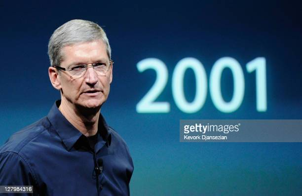 Apple CEO Tim Cook standing in front of a screen showing the year the iPod was launched speaks at the event introducing the new iPhone 4s at the...
