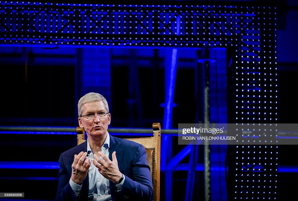 Apple CEO Tim Cook talks during the StartupDelta at the Startup Fest Europe in Amsterdam on May 24, 2016. The Startup Fest Europe gathers international keynote-speakers to discuss the latest innovations, products and services. The event runs from May 24 to 28, 2016. / AFP / ANP / Robin van Lonkhuijsen / Netherlands OUT