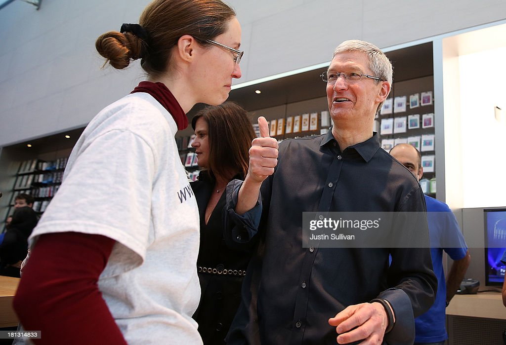 Apple CEO Tim Cook (R) talks with Dorothy Arndt (L) who just purchased the new iPhone on September 20, 2013 in Palo Alto, California. Apple launched two new models of iPhone: the iPhone 5S, which is preceded by the iPhone 5, and a cheaper, paired down version, the iPhone 5C. The phones come with a new operating system.