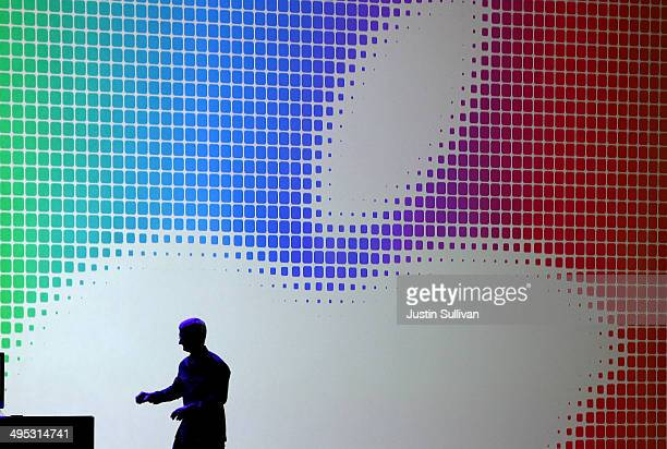 Apple CEO Tim Cook walks off stage after speaking during the Apple Worldwide Developers Conference at the Moscone West center on June 2 2014 in San...