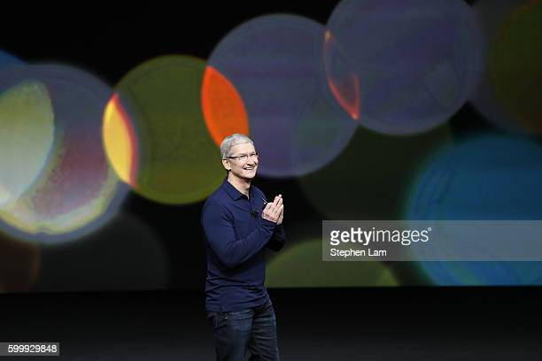 Apple CEO Tim Cook waves as he arrives on stage during a launch event on September 7 2016 in San Francisco California Apple Inc is expected to unveil...