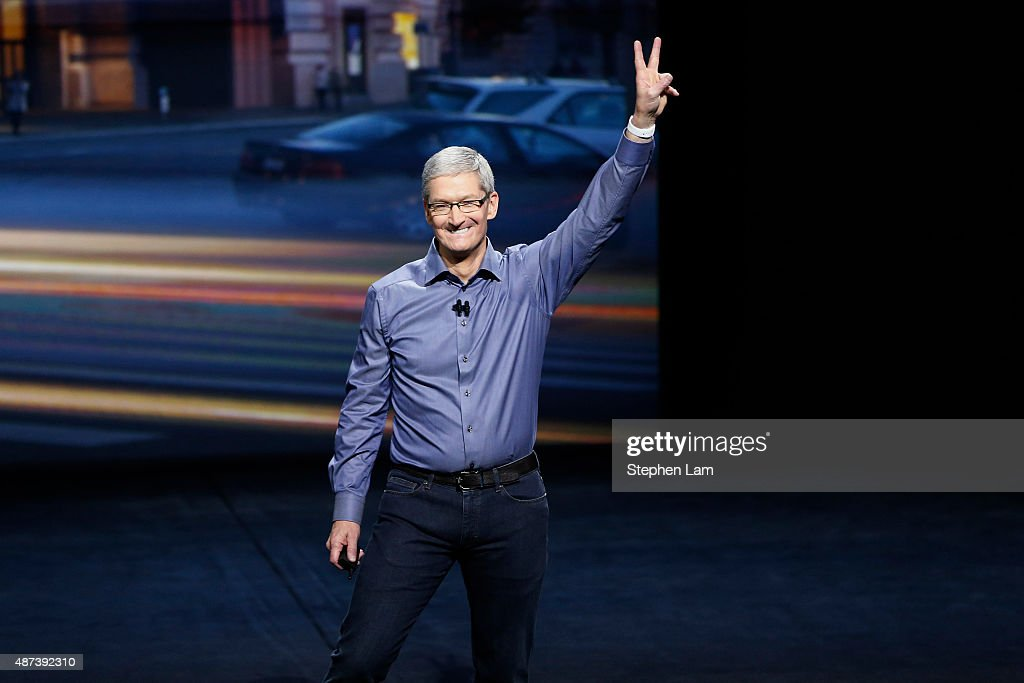 Apple CEO Tim Cook waves as he arrives on stage during an Apple Special Event on at Bill Graham Civic Auditorium September 9, 2015 in San Francisco, California. Apple Inc is expected to unveil latest iterations of its smart phone, forecasted to be the 6S and 6S Plus. The tech giant is also rumored to be planning to announce an update to its Apple TV set-top box.