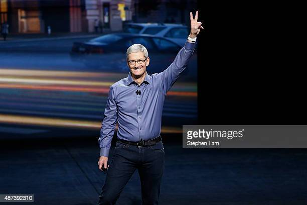 Apple CEO Tim Cook waves as he arrives on stage during an Apple Special Event on at Bill Graham Civic Auditorium September 9 2015 in San Francisco...