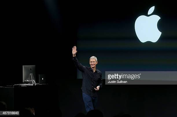 Apple CEO Tim Cook waves during an Apple special event on October 16 2014 in Cupertino California Apple unveiled the new iPad Air 2 and iPad mini 3...