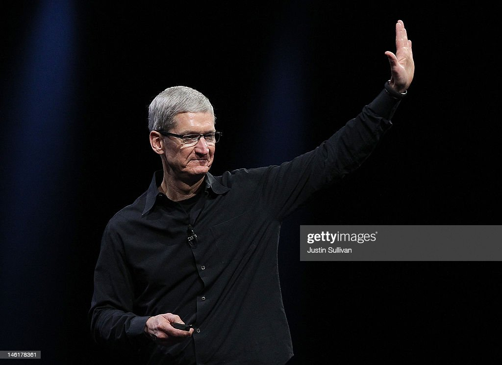 Apple CEO Tim Cook waves during the keynote address at the Apple 2012 World Wide Developers Conference (WWDC) at Moscone West on June 11, 2012 in San Francisco, California. Apple unveiled a slew of new hardware and software updates at the company's annual developer conference which runs through June 15.