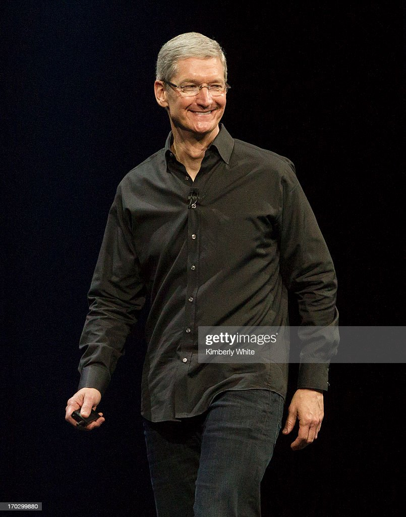 Apple CEO Tim Cook waves during the keynote address during the 2013 Apple Apple Worldwide Developers Conference at the Moscone Center on June 10, 2013 in San Francisco, California. Apple introduced a new mobile operatng system iOS 7, hardware upgrades and a new operating system OS X Mavericks during the keynote qaddress. The annual developer conference runs through June 14.