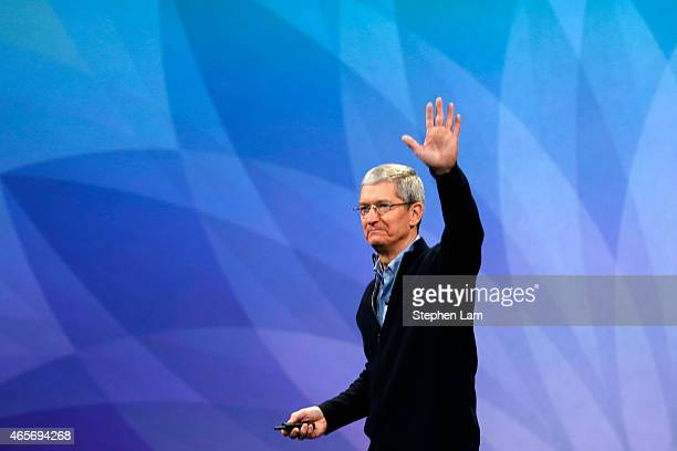 Apple CEO Tim Cook waves from stage after an Apple special event at the Yerba Buena Center for the Arts on March 9 2015 in San Francisco California...