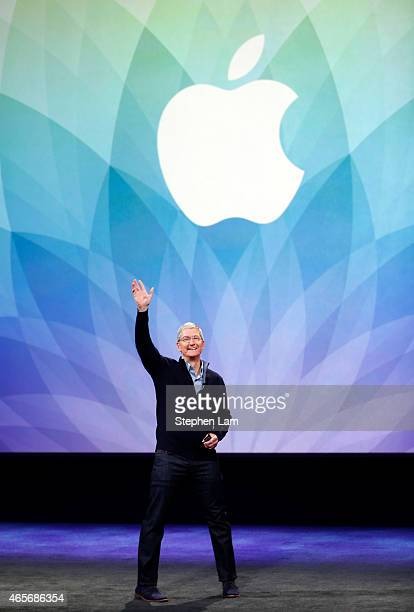 Apple CEO Tim Cook waves while on stage during an Apple special event at the Yerba Buena Center for the Arts on March 9 2015 in San Francisco...