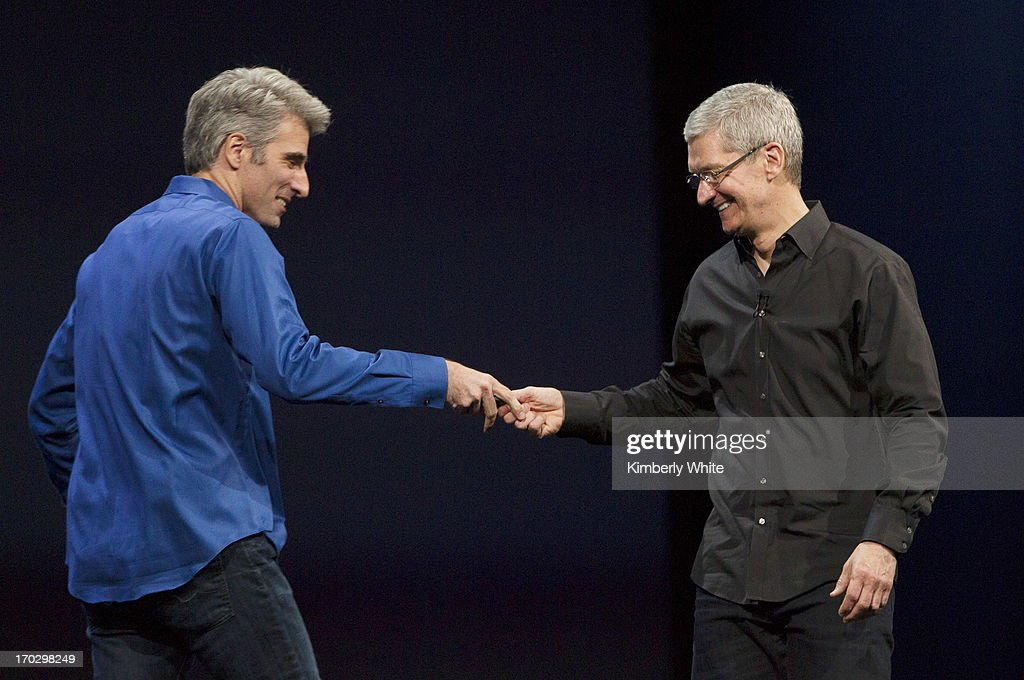 Apple CEO Tim Cook (R) welcomes Craig Federighi, vice president of Software Engineering, on stage during a keynote address during the 2013 Apple WWDC at the Moscone Center on June 10, 2013 in San Francisco, California. Apple introduced a new mobile operatng system iOS 7, hardware upgrades and a new operating system OS X Mavericks during the keynote qaddress. The annual developer conference runs through June 14.