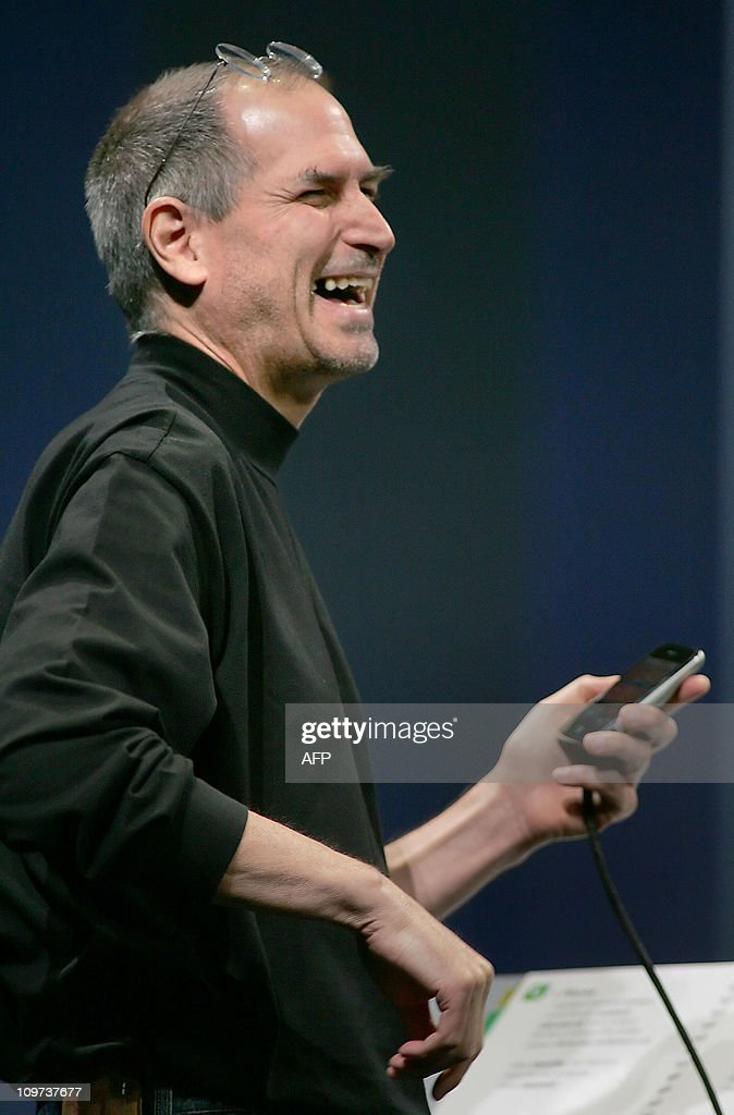 Apple chief executive Steve Jobs laughs as he shows the new iPhone during the Macworld Conference in San Francisco 09 January 2007. Apple Computer unveiled its new iPhone, an all-in-one mobile telephone, digital music player and camera that it hopes will revolutionize the mobile phone market.