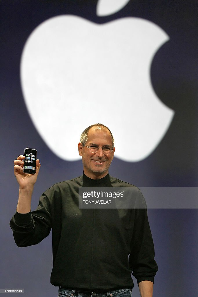 Apple chief executive Steve Jobs unveils a new mobile phone that can also be used as a digital music player and a camera a longanticipated device...