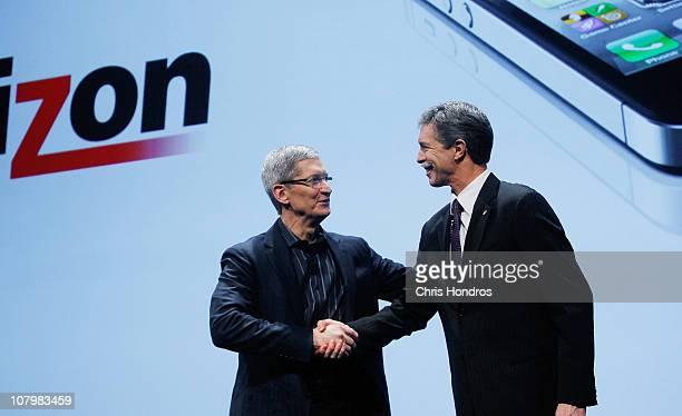 Apple Chief Operating Officer Tim Cook shakes hands with Verizon Wireless CEO Dan Mead during the iPhone announcement January 11 2011 in New York...