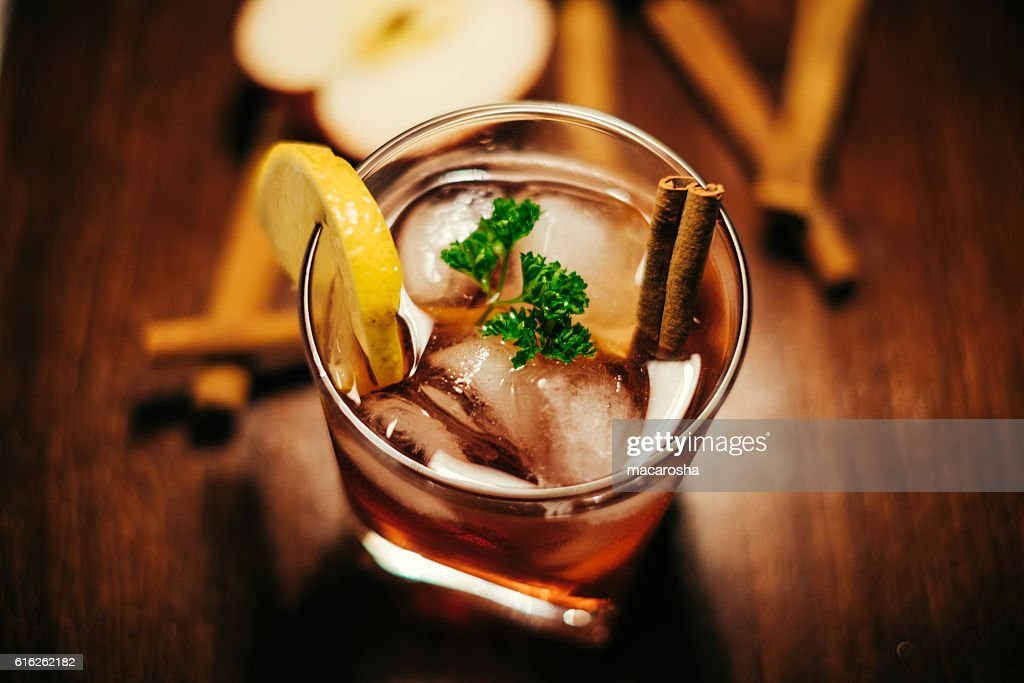 apple cider with cinnamon whiskey : Stock Photo