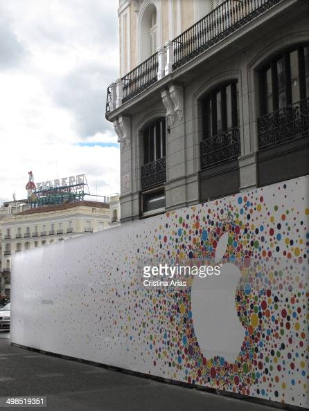 Apple company logo in the works of reform for the opening of its new flagship store in Madrid in Puerta del Sol and the bottom image shows the logo...