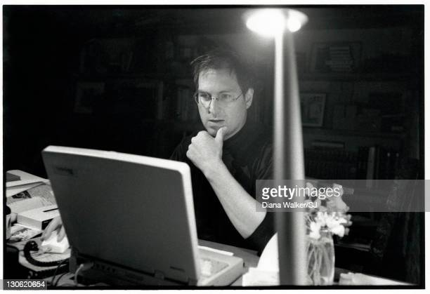 Apple Computer CEO Steve Jobs is photographed working on his Macworld Expo speech announcing Apple alliance w Microscoft in his home office the night...
