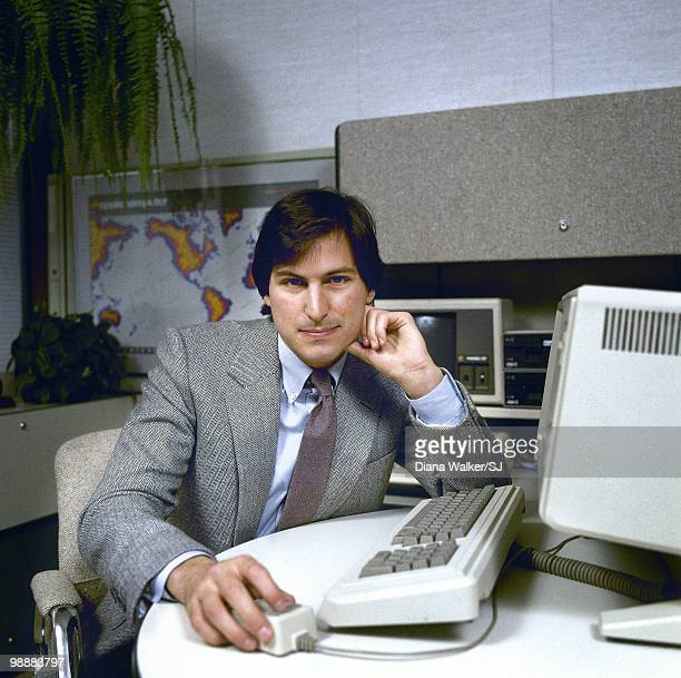 Apple Computer CEO Steve Jobs poses with the 'Lisa' Computer in 1982