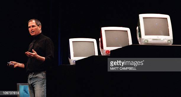 Apple Computer CEO Steve Jobs stands alongside the lineup of new Apple iMac computers during the keynote speech at the Macworld Conference 19 July...