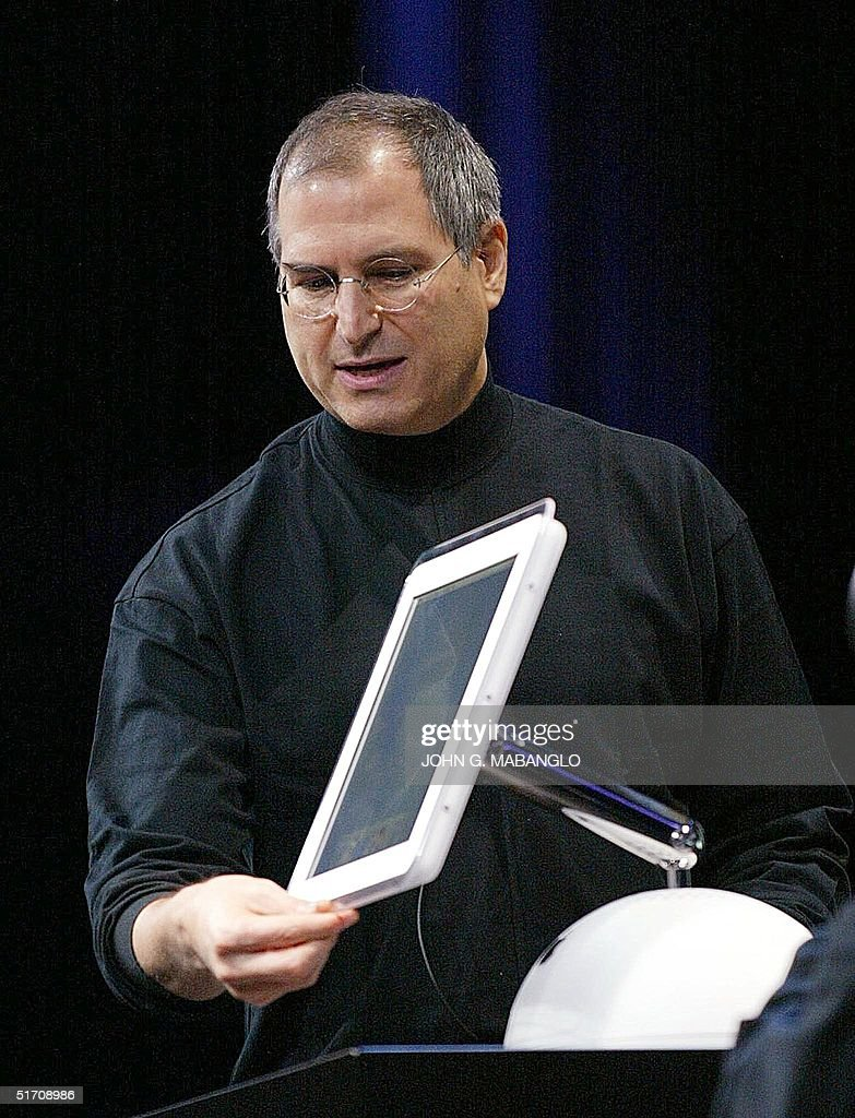 Apple Computer co-founder and CEO <a gi-track='captionPersonalityLinkClicked' href=/galleries/search?phrase=Steve+Jobs&family=editorial&specificpeople=204493 ng-click='$event.stopPropagation()'>Steve Jobs</a> introduces the all-new flat-panel iMac computer during his keynote speech at the MacWorld Expo 07 January 2002 in San Francisco, California. 'Today, we say goodbye to the old iMac,' Apple CEO <a gi-track='captionPersonalityLinkClicked' href=/galleries/search?phrase=Steve+Jobs&family=editorial&specificpeople=204493 ng-click='$event.stopPropagation()'>Steve Jobs</a> told a packed auditorium of cheering admirers. 'And we introduce a new iMac, completely redesigned from the ground up.' AFP PHOTO/John G. MABANGLO